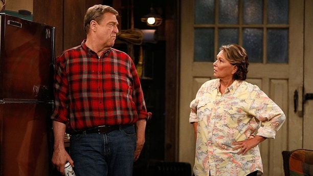 """ROSEANNE - """"Twenty Years to Life"""" - Roseanne and Dan adjust to living under the same roof with Darlene and her two children, Harris and Mark, when Darlene loses her job. Meanwhile, Becky announces she is going to be a surrogate to make extra money; and Roseanne and Jackie are at odds with one another, on the season premiere and first episode of the revival of """"Roseanne,"""" TUESDAY, MARCH 27 (8:00-8:30 p.m. EDT), on The ABC Television Network. (ABC/Adam Rose)JOHN GOODMAN, ROSEANNE BARR"""
