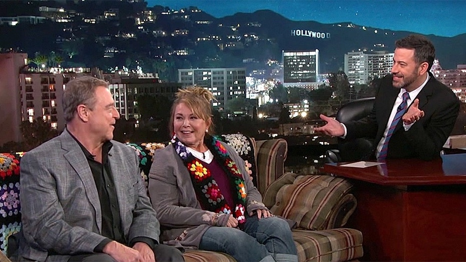 """Jimmy Kimmel addresses the """"Roseanne"""" cancellation on his Tuesday night show with a possible spinoff solution. Here, Kimmel interviews Roseanne Barr and John Goodman back in March, before the show's reboot premiere."""