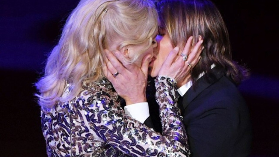 Nicole Kidman, left, smooches her husband Keith Urban at the Lincoln Center's American Songbook Gala at Alice Tully Hall in New York City.