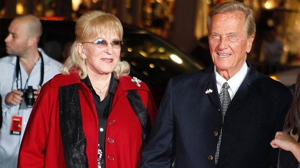 """Singer Pat Boone (R) and his wife, Shirley, arrive as guests for a screening in honor of the """"West Side Story: 50th Anniversary Edition"""" Blu-ray release in Hollywood, California November 15, 2011. The film won 10 Academy Awards in 1962, including best supporting actor and actress awards for George Chakiris and Rita Moreno and for best picture. REUTERS/Fred Prouser (UNITED STATES - Tags: ENTERTAINMENT ANNIVERSARY) - GM1E7BG18ZN01"""