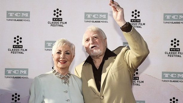 """Actors Shirley Jones and Marty Ingels pose during 50th anniversary screening of musical drama film """"The Sound of Music"""" at the opening night gala of the 2015 TCM Classic Film Festival in Los Angeles, California March 26, 2015. REUTERS/Kevork Djansezian - GF10000040250"""