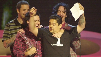 Members of the band NOFX celebrate after being named Snowboarding's Music Artist of the Year during the ESPN Action Sports & Music Awards at the Universal Amphitheatre April 7, 2001 in Los Angeles. The show is scheduled for broadcast in the United States on Tuesday, April 10 on ESPN.