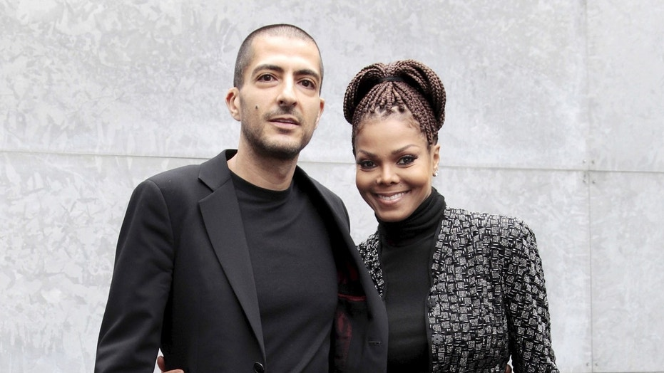 U.S. singer Janet Jackson (R) and her then boyfriend Wissam Al Mana pose for photographers as they arrive to attend the Giorgio Armani Autumn/Winter 2013 collection at Milan Fashion Week, February 25, 2013.      REUTERS/Alessandro Garofalo/File Photo - RTSRYVN