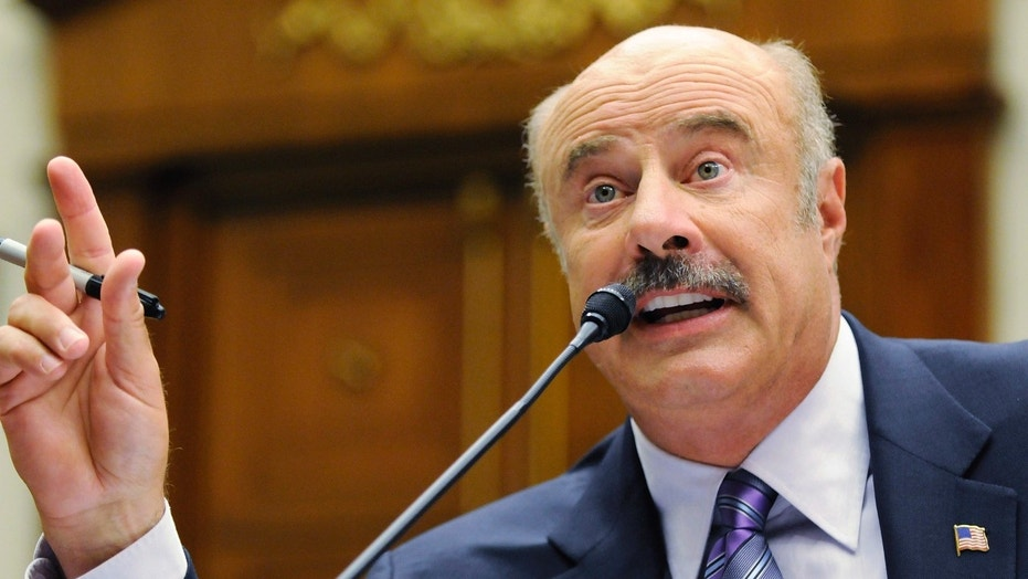 Dr. Phil McGraw was seen in a newly released video hitting a man on a skateboard with his car.