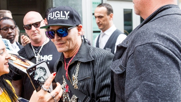 Johnny Depp and Joe Perry are seen arriving at the regent Hotel in Berlin, Germany.