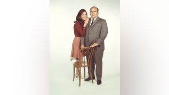 American actors Mary Tyler Moore, as Mary Richards, and Ed Asner, as Lou Grant, pose for a publicity photo for the CBS situation comedy 'Mary Tyler Moore,' California, 1971. (Photo by CBS Photo Archive/Getty Images)