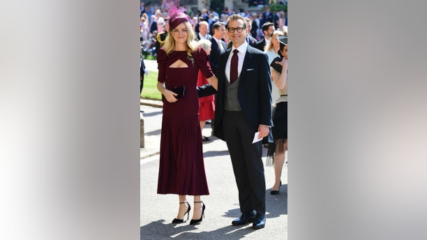 Gabriel Macht and wife Jacinda Barrett arrive for the wedding ceremony of Prince Harry and Meghan Markle at St. George's Chapel in Windsor Castle in Windsor, near London, England, Saturday, May 19, 2018. (Ian West/pool photo via AP)