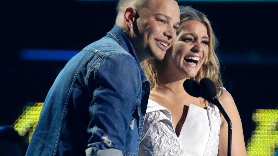Kane Brown, left, and Lauren Alaina accept the collaborative video of the year award at the CMT Music Awards at the Bridgestone Arena on Wednesday, June 6, 2018, in Nashville, Tenn.