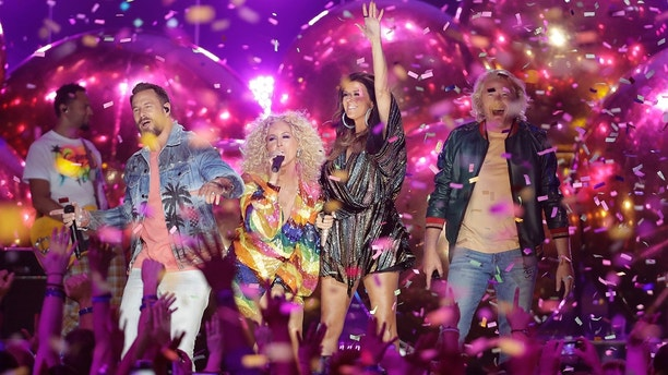 "Jimi Westbrook, from left, Kimberly Schlapman, Karen Fairchild, and Phillip Sweet, of Little Big Town, perform ""Summer Fever"" at the CMT Music Awards at the Bridgestone Arena on Wednesday, June 6, 2018, in Nashville, Tenn. (AP Photo/Mark Humphrey)"