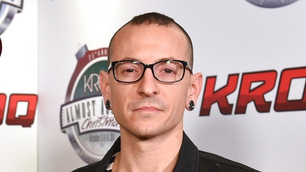 FILE - In this Dec. 13, 2014 file photo, Chester Bennington poses in the press room at the 25th annual KROQ Almost Acoustic Christmas in Inglewood, Calif. The Los Angeles County coroner says Bennington, who sold millions of albums with a unique mix of rock, hip-hop and rap, has died in his home near Los Angeles. He was 41. Coroner spokesman Brian Elias says they are investigating Bennington's death as an apparent suicide but no additional details are available. (Photo by John Shearer/Invision/AP, File)
