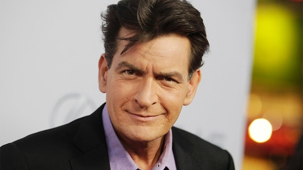 "Cast member Charlie Sheen poses at the premiere of his new film ""Scary Movie 5"" in Hollywood April 11, 2013.