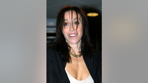 "Former Hollywood madame Heidi Fleiss poses during an in-store appearance to promote her new book ""Pandering,"" at Borders Books and Music in Westwood, California.