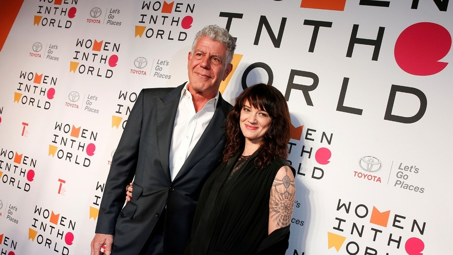 Anthony Bourdain poses with Italian actor and director Asia Argento for the Women In The World Summit in New York City, April 12, 2018.