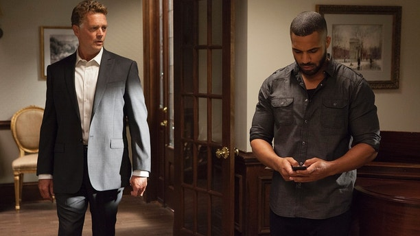 "John Schneider, left, and Tyler Lepley in a scene from Season 4 of Tyler Perry's ""The Haves and the Have Nots."""