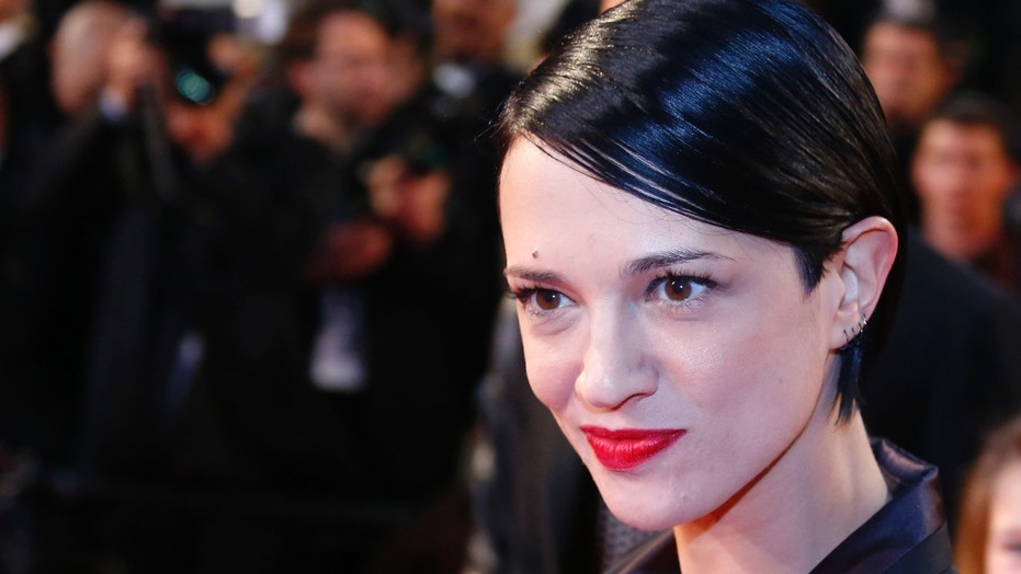 THe photographer who snapped Asia Argento with French reporter Hugo Clément just a few days before her boyfriend, Anthony Bourdain, committed suicide.