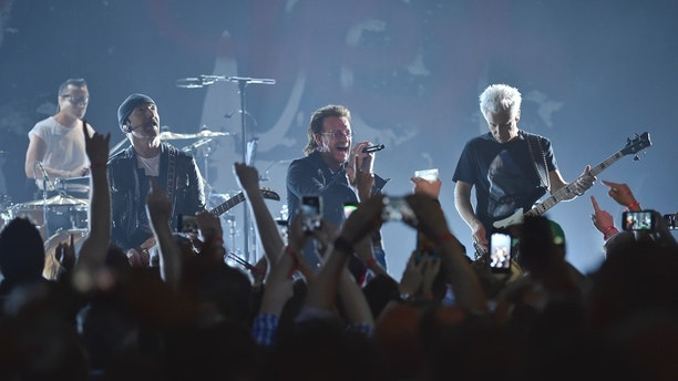 Larry Mullen Jr, left, The Edge, Bono and Adam Clayton of U2 perform during a concert at the Apollo Theater hosted by SiriusXM on Monday, June 11, 2018, in New York. (Photo by Evan Agostini/Invision/AP