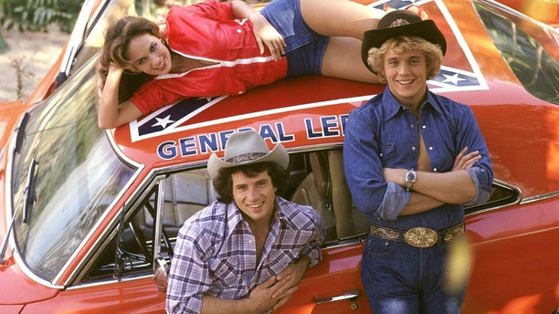 "John Schneider (right) with his ""Dukes of Hazzard"" co-stars Tom Wopat and Catherine Bach."