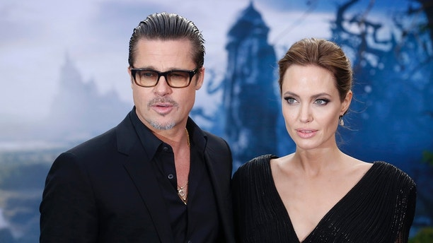 """Actors Brad Pitt and Angelina Jolie arrive for a special Maleficent Costume Display at Kensington Palace in London May 8, 2014. """"Maleficent"""" is the upcoming Disney film starring Angelina Jolie and Kensington Palace is the official residence of Prince William and Catherine, Duchess of Cambridge. REUTERS/Luke MacGregor  (BRITAIN - Tags: ENTERTAINMENT FASHION SOCIETY ROYALS) - GM1EA59072F01"""