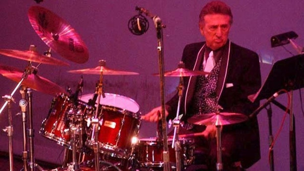 In this Oct. 16, 2004 file photo, longtime Elvis Presley drummer D.J. Fontana performs at the 50th anniversary celebration concert of Elvis Presley's first performance at the Louisiana Hayride in Sherveport, La.