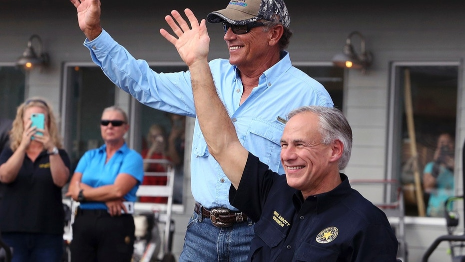 "In this Sept. 21, 2017, file photo, George Strait, left, and Texas Gov. Greg Abbott wave to the crowd in Rockport, Texas, during a visit with individuals affected by Hurricane Harvey. Strait leads a new tourism campaign for Hurricane Harvey-damaged Rockport and Fulton nearly 10 months after the storm devastated the area he sometimes calls home. Strait is part of the ""Find Yourself in Rockport-Fulton"" radio and TV campaign to encourage tourists to return to the area hard-hit when Harvey made landfall in August."