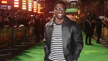 "FILE - In this Dec. 7, 2017 file photo, Kevin Hart poses for photographers upon arrival at premiere of the film 'Jumanji, Welcome To The Jungle' in London.  Hart's private jet blew a tire landing at Boston's Logan Airport on Thursday, May 3, 2018.  In a Snapchat video, Hart said it ""fishtailed like crazy."" The 38-year-old said ""I got real angels on my back.""(Photo by Joel C Ryan/Invision/AP, File"