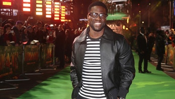 """FILE - In this Dec. 7, 2017 file photo, Kevin Hart poses for photographers upon arrival at premiere of the film 'Jumanji, Welcome To The Jungle' in London.  Hart's private jet blew a tire landing at Boston's Logan Airport on Thursday, May 3, 2018.  In a Snapchat video, Hart said it """"fishtailed like crazy."""" The 38-year-old said """"I got real angels on my back.""""(Photo by Joel C Ryan/Invision/AP, File"""