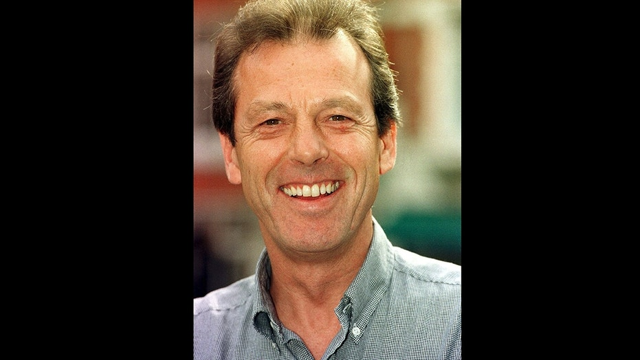 """This Sept. 11, 1997 file photo shows actor Leslie Grantham in London. Leslie Grantham, who played arch-villain """"Dirty Den"""" Watts on British soap opera """"EastEnders,"""" has died at the age of 71. Grantham's management, Advocate Agency, says he died Friday, June 15, 2018 but did not disclose the cause of death."""