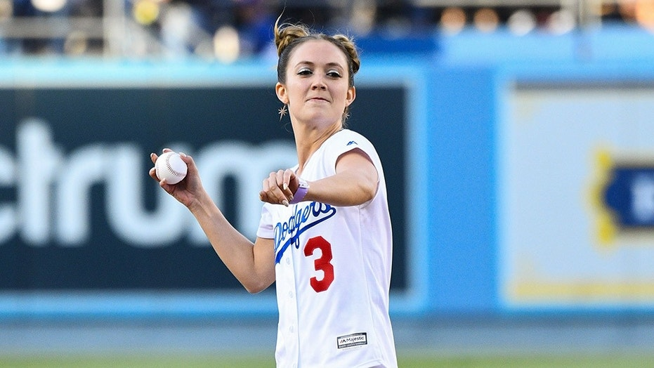 Actor Billie Lourd throws out the first pitch Friday before a Dodgers-Giants game at Dodger Stadium in Los Angeles, June 15, 2018.