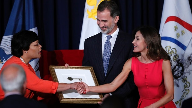 King Felipe VI and Queen Letizia of Spain receive ceremonial keys to the city given to them by New Orleans Mayor LaToya Cantrell, left, at a welcoming ceremony at Gallier Hall in New Orleans, Friday, June 15, 2018. They are in New Orleans to help celebrate the city's 300th anniversary, which was colonized by Spain from 1763 to 1802. (AP Photo/Gerald Herbert)