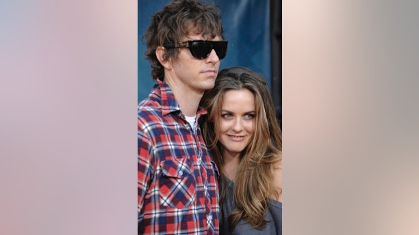 "FILE - In this Thursday July 31, 2008 file photo, Christopher Jarecki and Alicia Silverstone arrive at the premiere of ""Pineapple Express"" in Mann Village Theater in Los Angeles. Alicia Silverstone is divorcing her husband of nearly 13 years. The ""Clueless"" actress filed for divorce from Christopher Jarecki on Friday, May 25, 2018 in Los Angeles County Superior Court. (AP Photo/Chris Pizzello, File)"
