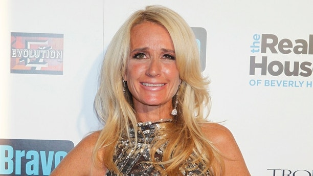 """Cast member Kim Richards of Bravo's new reality series """"The Real Housewives of Beverly Hills"""" poses at the premiere party in Los Angeles October 11, 2010. The series begins October 14. Photo taken October 11, 2010. REUTERS/Fred Prouser  (UNITED STATES - Tags: ENTERTAINMENT) - RTXTBY4"""
