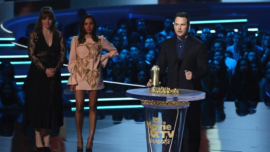 In this Saturday, June 16, 2018, photo, Chris Pratt, right, accepts the generation award as Bryce Dallas Howard, from left, and Aubrey Plaza look on at the MTV Movie and TV Awards at the Barker Hangar in Santa Monica, Calif. (Photo by Matt Sayles/Invision/AP)