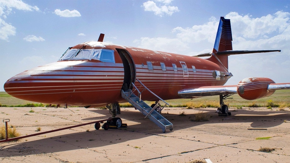 This undated file photo provided by GWS Auctions, Inc. shows a private jet once owned by Elvis Presley, on a runway in New Mexico.