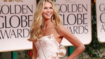 Model Elle Macpherson poses as she arrives at the 69th annual Golden Globe Awards in Beverly Hills, California January 15, 2012.