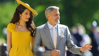 Amal Clooney and George Clooney arrive for the wedding ceremony of Prince Harry and Meghan Markle at St. George's Chapel in Windsor Castle in Windsor, near London, England, Saturday, May 19, 2018. (Gareth Fuller/pool photo via AP)