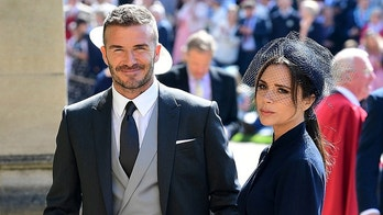 David and Victoria Beckham arrive at St George's Chapel at Windsor Castle for the wedding of Meghan Markle and Prince Harry. Saturday May 19, 2018.  Ian West/Pool via REUTERS - RC1F44EFA3B0