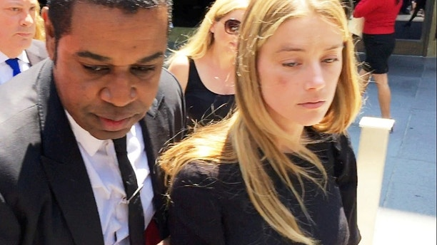 Actress Amber Heard leaves the Superior Court of Los Angeles in Los Angeles, California, U.S. May 27, 2016, with what appears to be a bruise on her right cheek after obtaining a restraining order against husband Johnny Depp in this still image from video. REUTERS/Rollo Ross     TPX IMAGES OF THE DAY      - S1BETGNKADAA