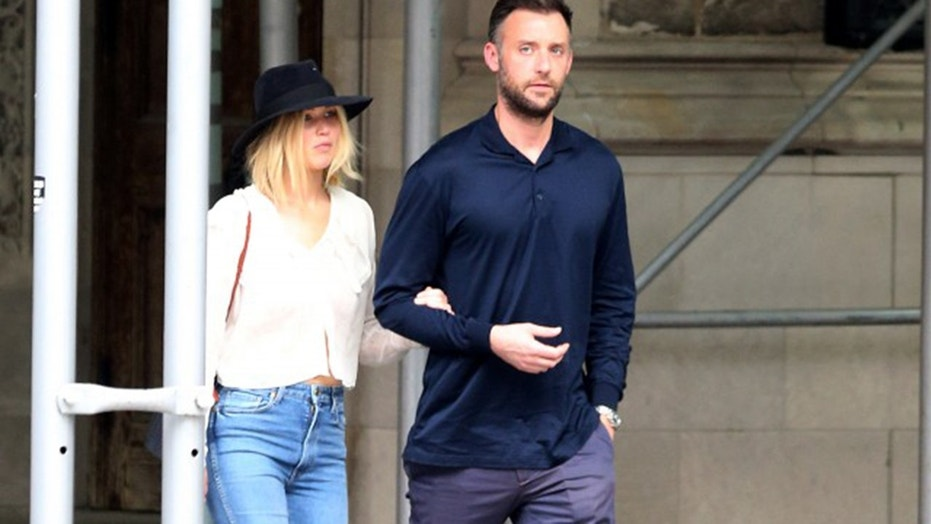 Jennifer Lawrence, left, and her boyfriend Cooke Maroney walked arm-in-arm in New York City.