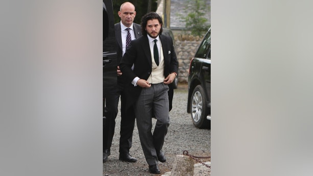 """CAPTION CORRECTS WEDDING INFO AND LOCATION Actor Kit Harington, arrives, at Rayne Church, Kirkton of Rayne in Aberdeenshire, Scotland, Saturday June 23, 2018. Former """"Game of Thrones"""" co-stars Kit Harington and Rose Leslie are marrying Saturday with a celebration at the bride's family castle in Scotland. The couple and guests arrived at Rayne Church, close to the 900-year-old Wardhill Castle in northeast Scotland, which is owned by Leslie's family. (Jane Barlow/PA via AP)"""