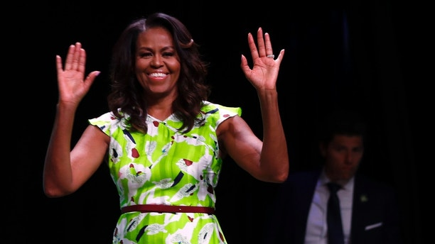 Former first lady Michelle Obama waves as she arrives to speak at the American Library Association annual conference in New Orleans, Friday, June 22, 2018. (AP Photo/Gerald Herbert)