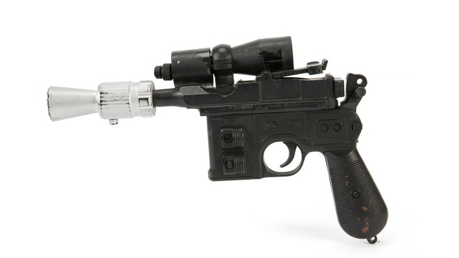 """Han Solo's BlasTech DL-44 Blaster from the Star Wars trilogy film """"Return of the Jedi"""" sold for $550,000."""