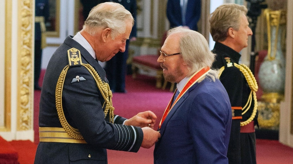 Knight fever: Bee Gees star becomes Sir Barry Gibb at palace