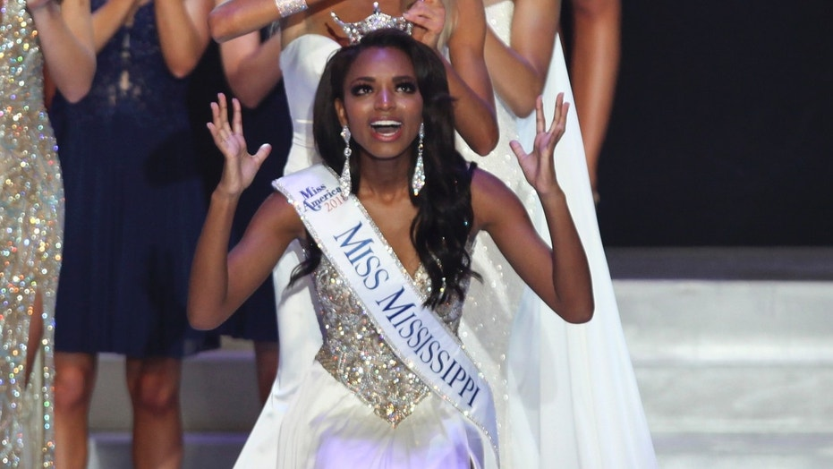 Miss Tupelo Asya Branch reacts to being crowned Miss Mississippi 2018 during the Miss Mississippi Pageant in Vicksburg, Miss., June 23, 2018.