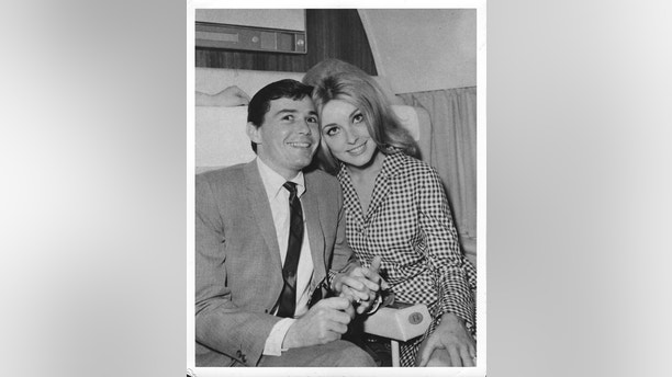 CIRCA 1966:  Actress Sharon Tate and hair dresser Jay Sebring pose for a portrait on a plane circa  1966.  (Photo by Michael Ochs Archives/Getty Images)