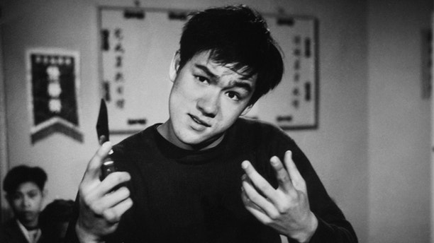 LOS ANGELES - CIRCA MID 1960's:  Bruce Lee portrays a young thug in an early TV performance circa the mid 1960's in Los Angeles California. (Photo by Michael Ochs Archive/Getty Images)