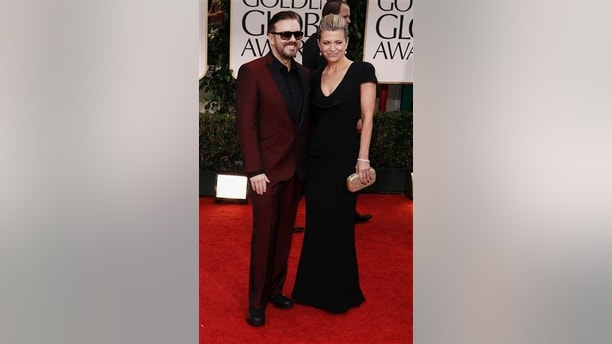 Ricky Gervais, left, and Jane Fallon arrive at the 69th Annual Golden Globe Awards Sunday, Jan. 15, 2012, in Los Angeles. (AP Photo/Matt Sayles)