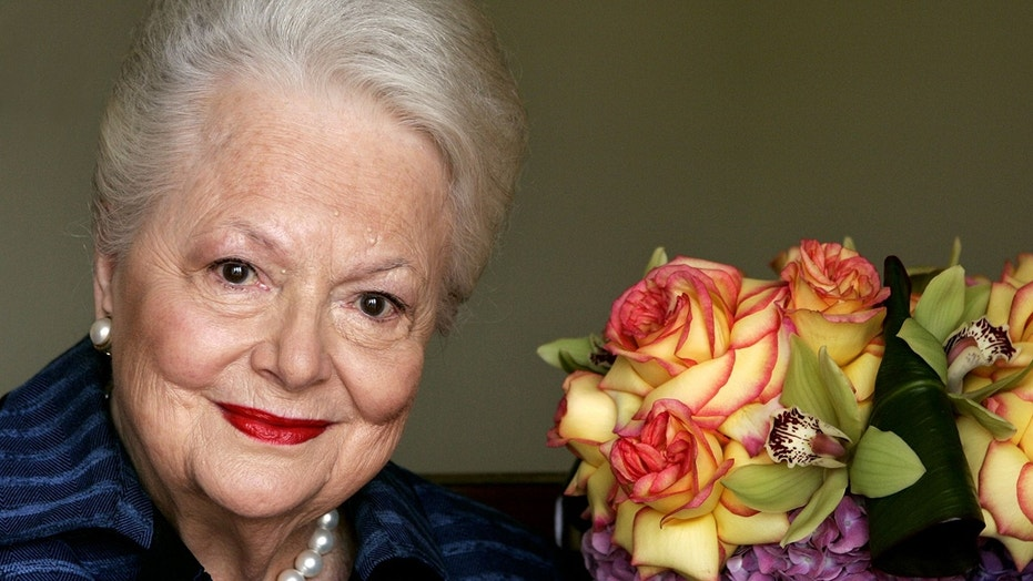 """Actress Olivia de Havilland, who played the doomed Southern belle Melanie in """"Gone With the Wind,"""" poses for a photograph Wednesday, Sept. 15, 2004, in Los Angeles. (AP Photo/Kevork Djansezian)"""