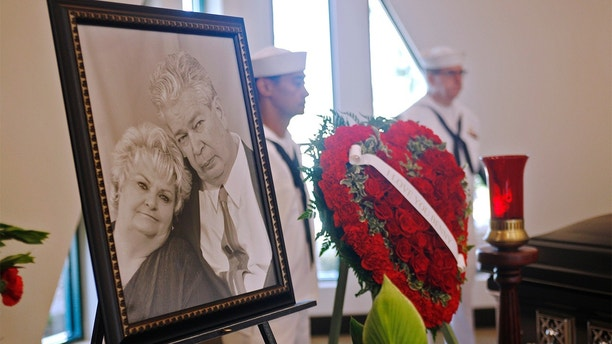 """A photo of Richard """"The Old Man"""" Harrison and his wife JoAnne Rhue Harrison is on display near his casket at Palm Mortuary in Las Vegas, Sunday, July 1, 2018. Well known as the patriarch in the Pawn Stars T.V. show, he died Monday after a long battle with Parkinson's disease. A public viewing was open in the morning followed by a service for family and friends. (Rachel Aston/Las Vegas Review-Journal via AP)"""