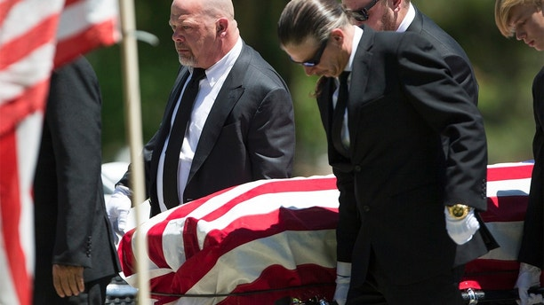 """Reality television personality Rick Harrison, left, serves as a pallbearer during the funeral service of his father, """"Pawn Stars"""" patriarch, Richard Benjamin Harrison, known as """"The Old Man,"""" at Palm Northwest Mortuary in Las Vegas on Sunday, July 1, 2018. (Richard Bria/Las Vegas Review-Journal via AP)/Las Vegas Review-Journal via AP)"""