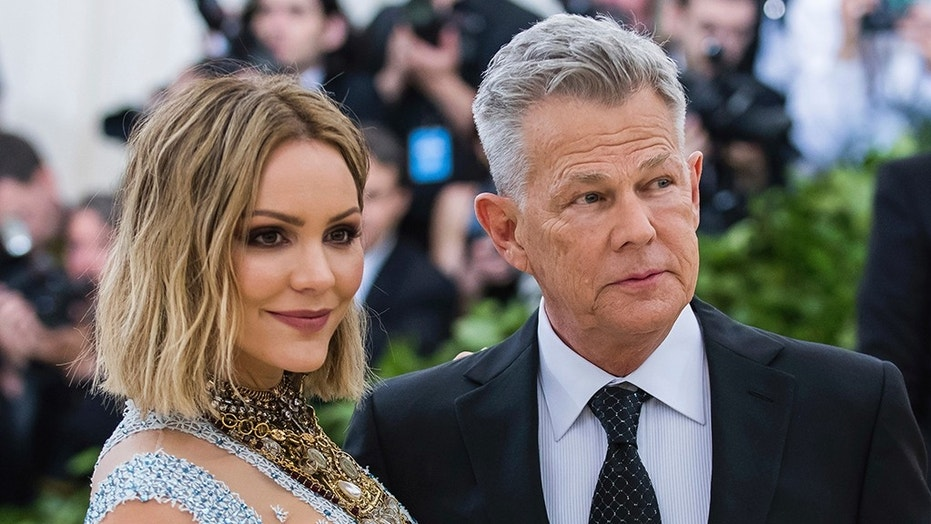 Katharine McPhee left and David Foster attend The Metropolitan Museum of Art's Costume Institute benefit gala celebrating the opening of the Heavenly Bodies Fashion and the Catholic Imagination exhibition on Monday